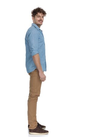 Photo pour happy casual man in denim shirt smiling and waiting in line, isolated on white background, full body - image libre de droit