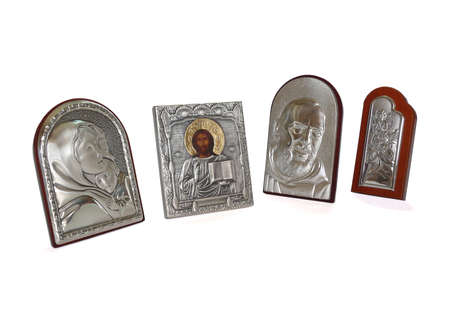 Different religious silver-plated icons over white