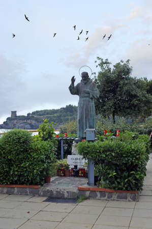 Saint Padre Pio bronze statue in the park, Marina di Camerota, Italy