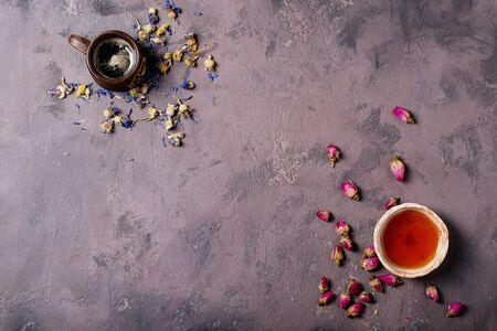 Photo pour Black tea in a ceramic cup versus espresso coffee over a brown texture background. Top view. Copy Space - image libre de droit