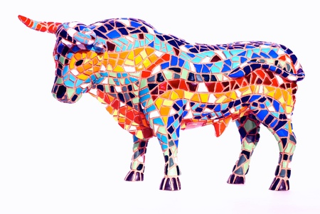 Miniature multicolored statue of bull in Gaudi style - traditional souvenir from Barcelona(Spain) . This is not art object, only inexpensive spanish gift.
