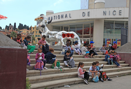 NICE, FRANCE - MAY 14, 2013: Children on steps of the Museum of Contemporary Art, major cultural and touristic landmark in Nice, France