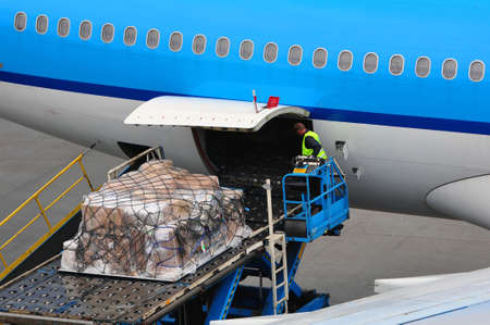 Air transportation: airplane loading cargo