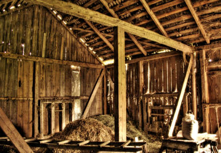 Interior of abandoned old barn at Lithuanian countryside