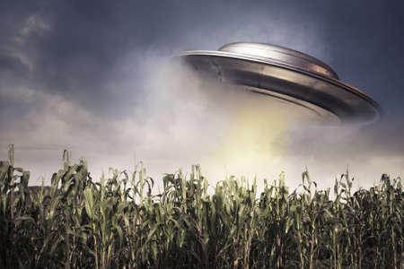 UFO over a crop field on a dark sky