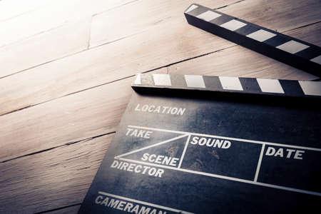 vintage photo of movie clapper on wood