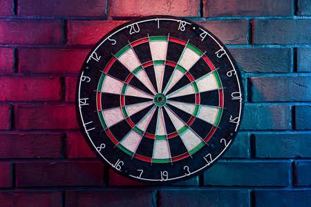 dartboard on a brick wall
