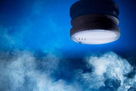 Photo pour smoke detector on a blue background - image libre de droit
