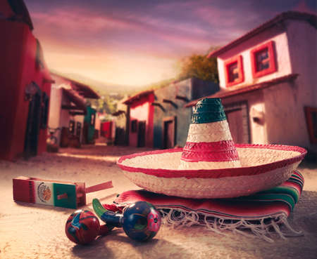 Mexican fiesta background with a hat sombrero and maracas in a mexican town