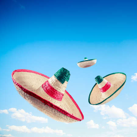 Mexican sombreros in a blue sky, square format