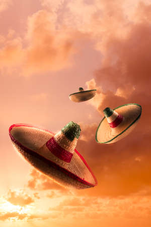 Mexican sombreros in a dramatic orange sky