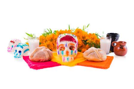 Photo pour sugar skull used for dia de los muertos celebration isolated on white with cempasuchil flowers - image libre de droit