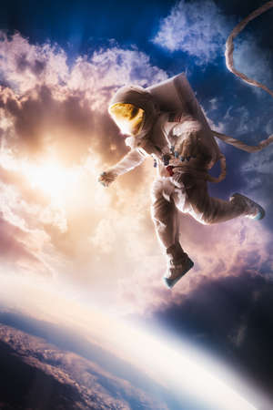 Photo pour Astronaut floating in the stratosphere near a planet - image libre de droit