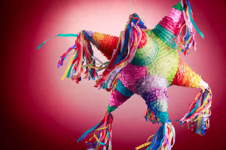 Photo pour Colorful mexican pinata used in birthdays on red background - image libre de droit