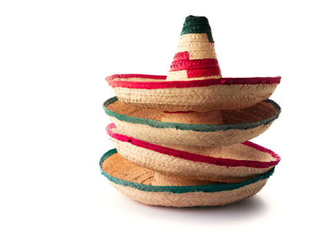 Mexican hats or sombreros stacked up on top of each other, isolated on white