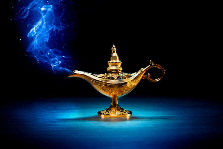 Photo for Magic genie lamp with smoke on a dark background - Royalty Free Image