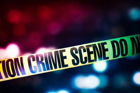 Foto de high contrast image of Crime scene tape with red and blue lights on the background - Imagen libre de derechos