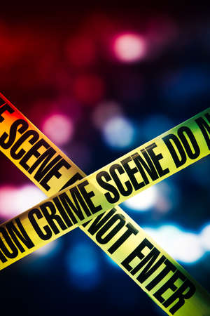 Photo pour high contrast image of Crime scene tape with red and blue lights on the background - image libre de droit