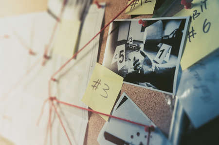 Foto de Detective board with evidence, crime scene photos and map. high contrast image - Imagen libre de derechos