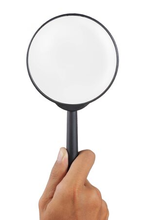 magnifier glass holded by man hand