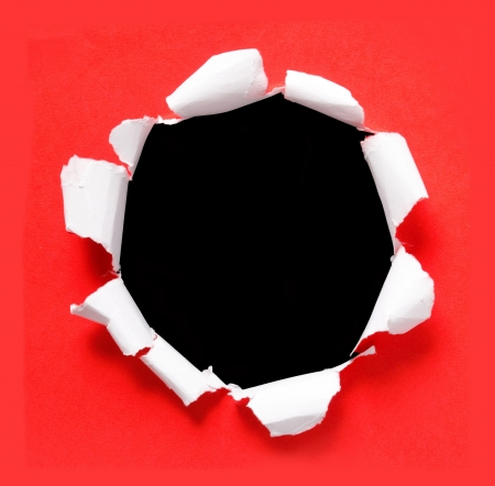 circle red torn paper with black background