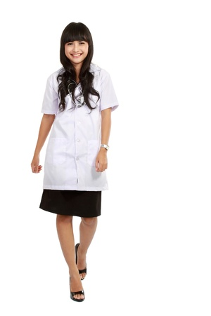 Nurse standing isolated over white background. asian woman nurse or young medical doctor smiling in full length.