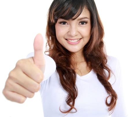 Portrait of an attractive young female with thumbs up. isolated over white background