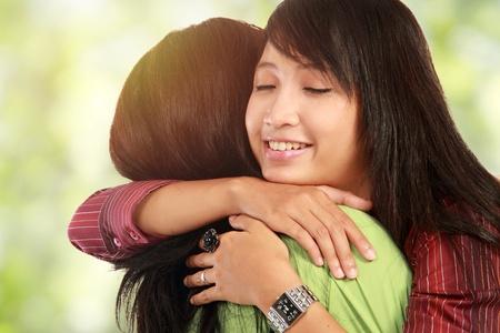 Foto de happy asian women hugging each other and smiling - Imagen libre de derechos