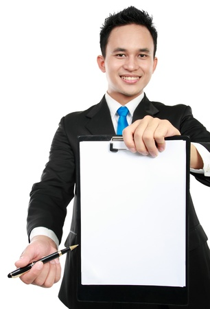 smiling young business man showing blank clipboard, isolated on white background