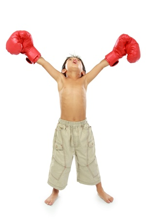portrait of happy young boy with boxing glove. winning pose