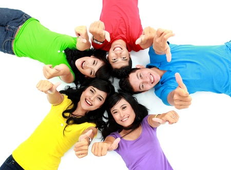 Photo for happy group of friends lay down on the floor showing thumb up - Royalty Free Image