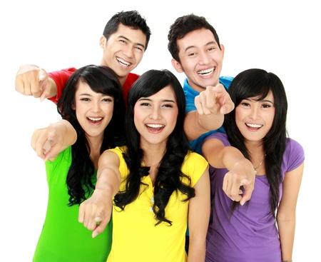 Foto de Happy joyful group of friends cheering pointing at camera - Imagen libre de derechos
