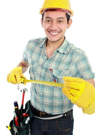 Portrait of an smiling happy worker using measuring tool