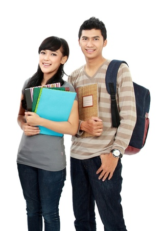 Photo pour potrait of boy and girl students holding notebooks and smiling - image libre de droit