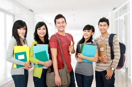 Photo pour potrait of students holding notebooks at school university - image libre de droit