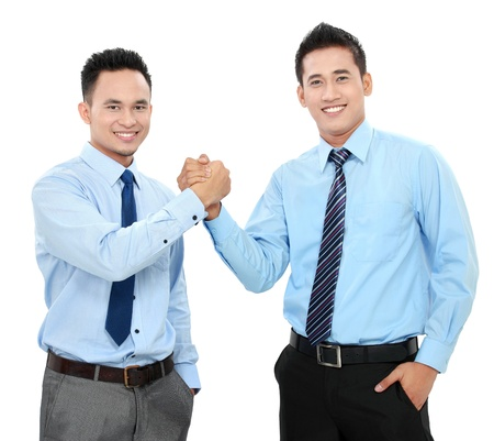 Portrait of two happy business men shaking hands isolated over white background