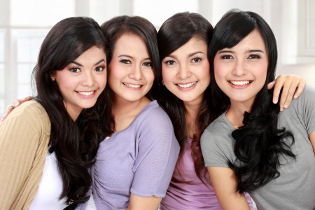 Group of beautiful asian women smiling