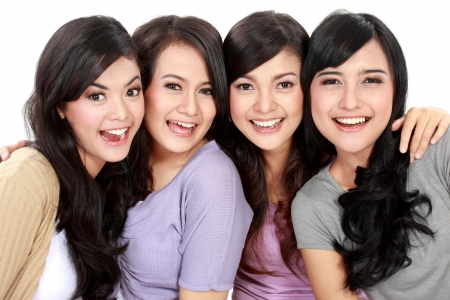 Group of beautiful women smiling isolated over a white background
