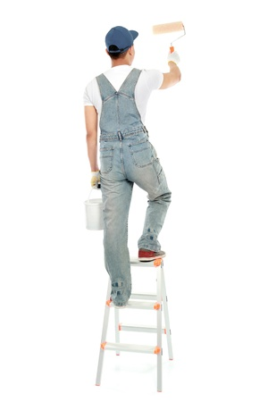 painter on the ladder painting the wall isolated on white background
