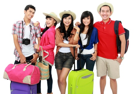 Foto de group of young people bringing bag and suitcase going on vacation - Imagen libre de derechos