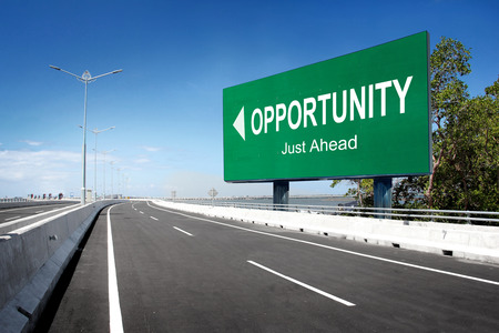 road with sign of opportunity. conceptual image