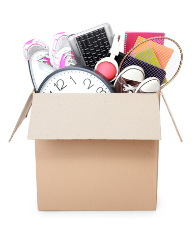 Cardboard box full of stuff ready for Moving Day isolated on white background