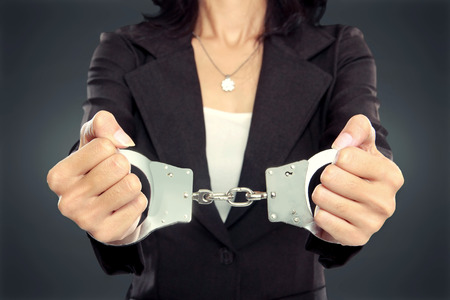 close up portrait of Young business woman in handcuffs. crime concept