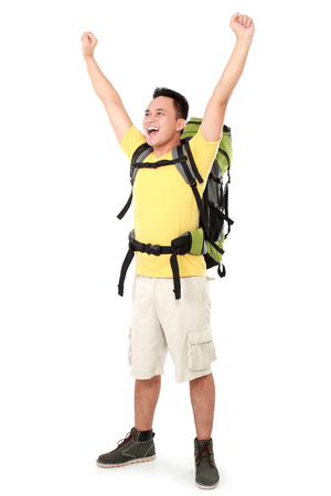 Full length portrait of male hiker with backpack raised his arm isolated on white background