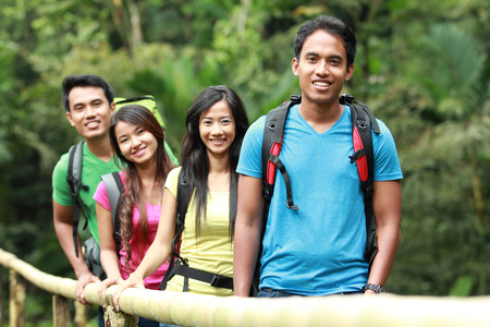 group of people hiking together. walking in the countryside