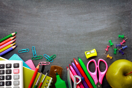 Foto für School supplies on blackboard background ready for your design - Lizenzfreies Bild