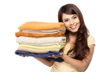 woman doing a housework holding laundry isolated over white background