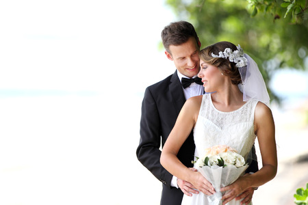 Foto de portrait of beautiful bride and handsome groom happy together with copy space - Imagen libre de derechos