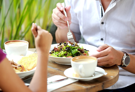 portrait of couple having lunch together at cafe