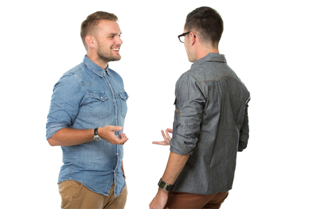 Photo for portrait of two young  man talking to each other, isolated over white background - Royalty Free Image